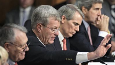Members of the deficit Super Committee meet on Capitol Hill. From left are Sen. Jon Kyl, Sen. Max Baucus, Sen. Rob Portman and Sen. John Kerry.