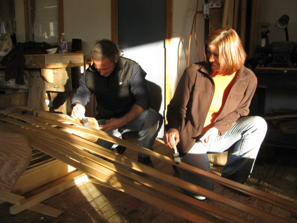 Jerry Driscoll of Winthrop, Mass., and Deborah Goldsmith of Rowley, Mass., put another coat of mineral wax sealer on the toboggan that they began making Saturday, Nov.5, at The Apprenticeshop in Rockland. &quotIt's such a fun thing,&quot Driscoll said of the weekend workshop.