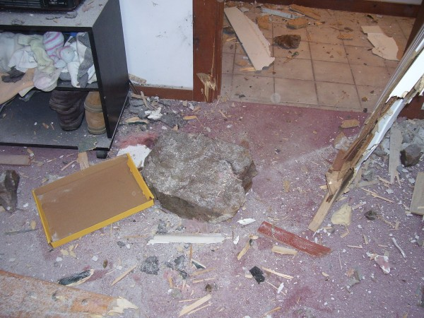 A rock the size of a thick phone book sits on the bedroom floor of Bruce Rich's home on Spruce Lane.