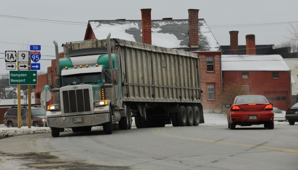 A trailer truck turns the corner by the Bangor police station on Summer Street in Bangor in Dec. 2010.