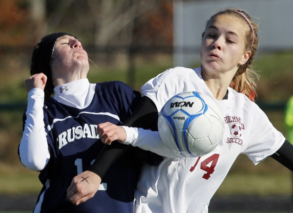 Van Buren's Courtney Parent (left) and Richmond's Amber Loon battle for the ball in the Class D soccer state championship in Falmouth on Saturday, Nov. 5, 2011.