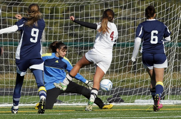 Richmond's Danica Hurley (4) beats Van Buren goalie Ashley Wilson to score in the second half of the Class D soccer state championship in Falmouth on Saturday, Nov. 5, 2011.