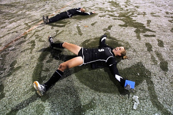 Skowhegan's Allison Lancaster (foreground) and Mikayla Toth make snow angels in celebration after their team defeated Marshwood in the snow for the field hockey state championship in Yarmouth on Saturday, Oct. 29, 2011.