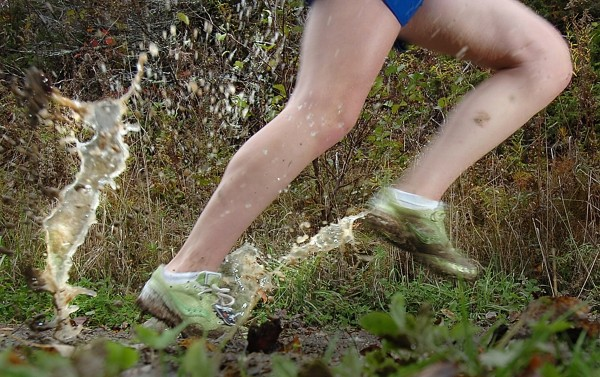 A female harrier sloshes through the mud on a rainy Eastern Regional Championship race in Belfast Oct. 22, 2011.
