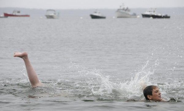 Dylan O'Brien, 9, appears elongated as he treads water at Lincolnville Beach on a rainy Tuesday, Aug. 16, 2011. The leg on the left actually belongs to his big brother Devin, 15, of Lincolnville who was snorkeling for hermit crabs.