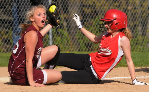 Nokomis third baseman Taylor Lovley reacts to a safe call after tagging Camden Hills runner Abby White during third-inning action at Rockport Friday, May 13, 2011. Camden Hills won 10-0.