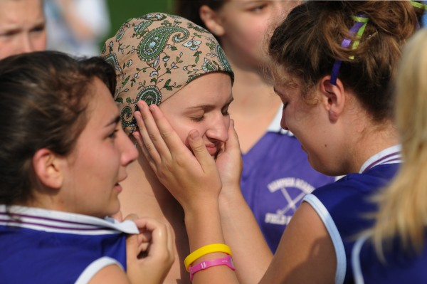 Kelsey Price (center), a junior at Hamden Academy, gets affection from her Hampden Academy field hockey teammates before they participated in the Champion the Cure Challenge in Brewer on Saturday, August 20, 2011. Price had been in treatment for Hodgkin's Lymphoma since it was discovered she had the disease in July.