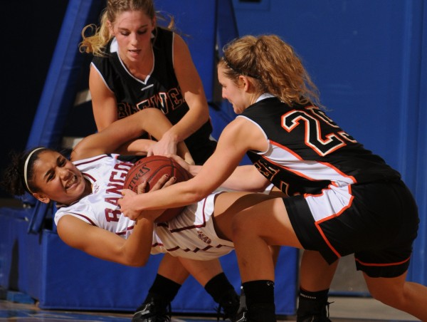 With just seconds to go in the fourth quarter and Brewer down by one point, Bangor's Denae Johnson hangs onto the ball as Brewer's Rylee Hutchins (center) and Faith Thomas attempt to pry the ball away in February. Bangor defeated Brewer 48-45.
