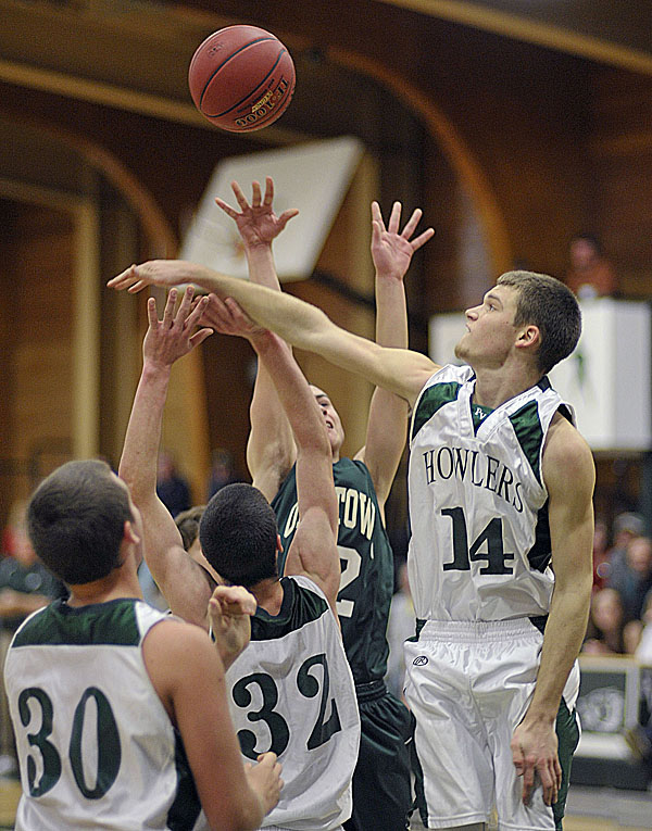 Penbosct Valley's Tom Millett (14) gets a block on a shot by Old Town's Tyler Lynch (22) in the first half of their preseason game  in Howland, Maine Tuesday, Nov. 29, 2011. The high school basketball season opens next weekend.