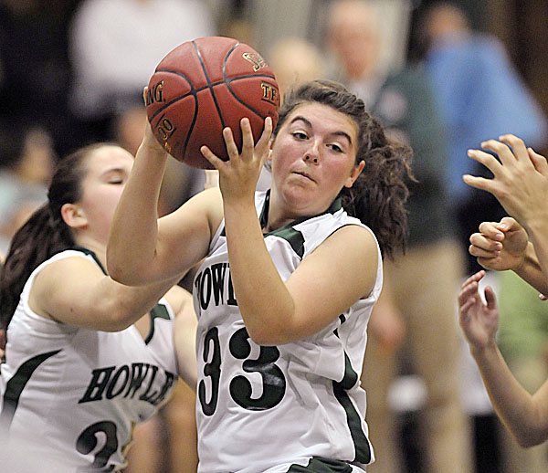 Penobscot Valley's Kristie Mackin (33) grabs a loose ball in the first half of a preseason game against the Old Town girls team in Howland, Maine Tuesday, Nov. 29, 2011.The high school basketball season opens next weekend.