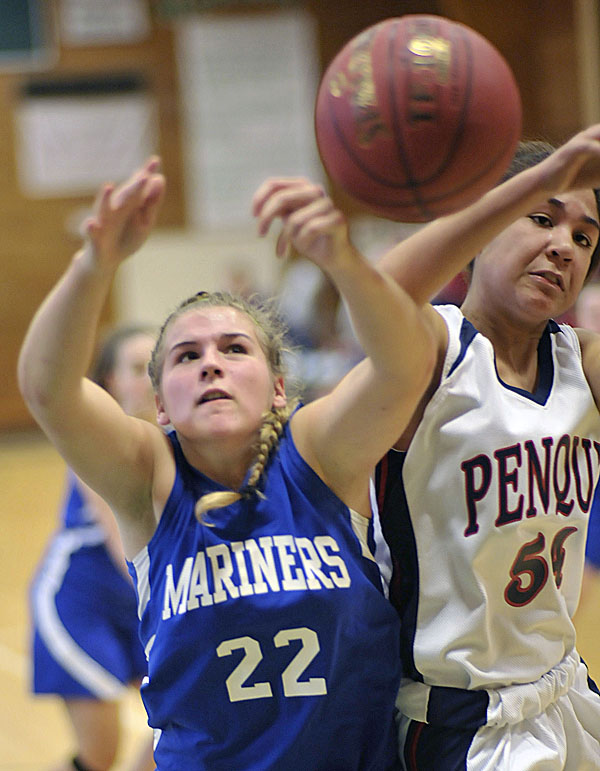 DI-Stonington's Chelsea Brown (22) tries for an offensive rebound while she collides with Penquis' Hannah Bess (54) in the first half of their preseason game in Howland, Maine Friday, Nov. 25, 2011. The high school basketball season opens next weekend.