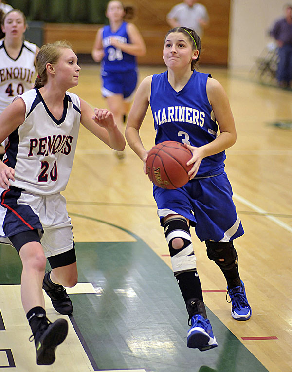 DI-Stonington's Janelli Ciomei (3) drives into the paint while guarded by Penquis' Lexi Larson (20) in the first half of a preseason game in Howland, Maine Friday, Nov. 25, 2011. The high school basketball season opens Dec. 9.