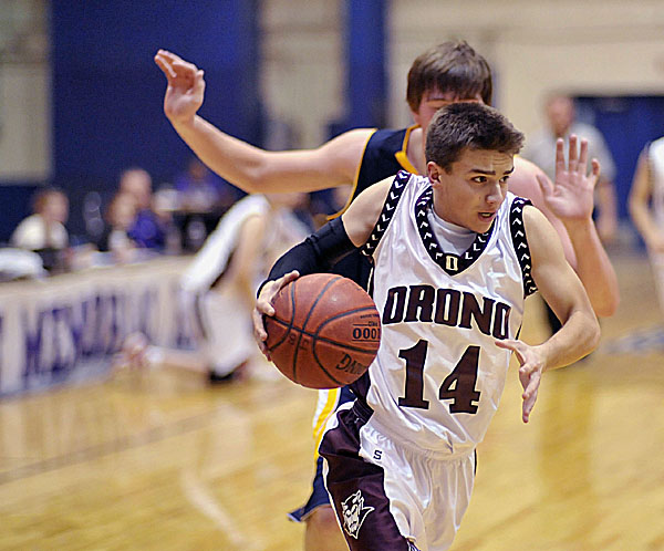 Orono's Cody St. Louis (14) drives into the paint during a recent preseason game against Medomak Valley. The high school basketball season opens this weekend.