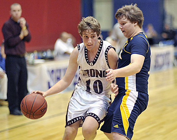 Orono's Ethan Hall (10) tries to work his way around Medomak Valley's Robbie Griffin (14) in preseason action at the Bangor Auditorium Saturday, Nov. 26, 2011. The high school basketball season opens this weekend.