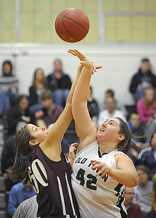 Orono High School's Jillian Woodward, left, and Old Town High School's Cortney Treadwell tip off at the start of Tuesday night's game in Old Town.