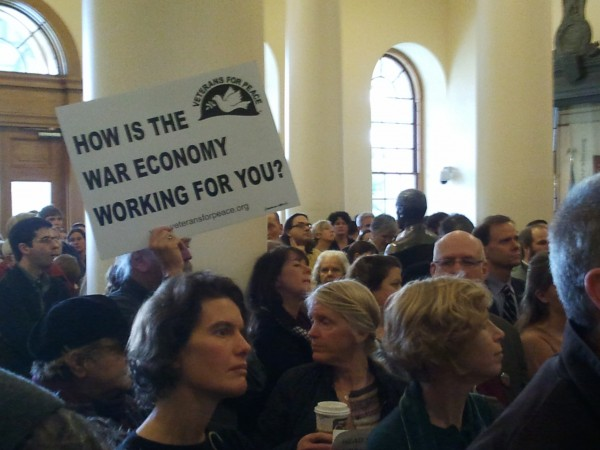 Demonstrators gather in the Hall of Flags in the State House in Augusta to protest cuts to MaineCare on Wednesday, Dec. 14, 2011.