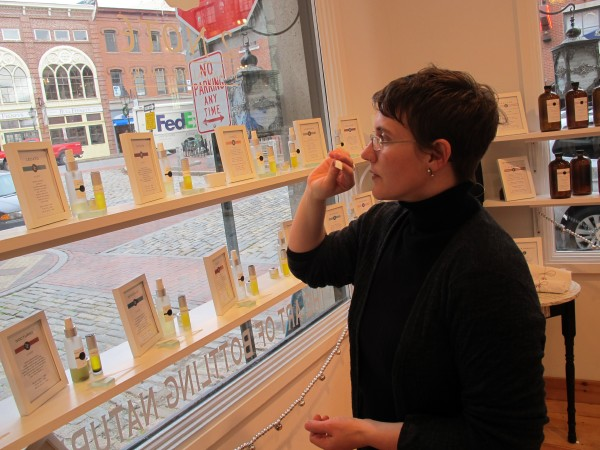 Carolyn Mix smells one of her handcrafted scents, at the 2 Note Botanical Perfumery store in Portland.