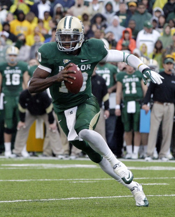 Baylor quarterback Robert Griffin III (10) finds running room behind the line of scrimmage against Texas in the first half of an NCAA college football game in Waco, Texas in December 2011. Griffin III has won The Associated Press college football player of the year, adding another award to his impressive postseason haul.