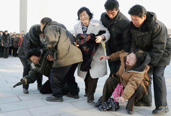 Women collapse in tears as North Koreans gather after learning death of their leader Kim Jong Il on Monday, Dec. 19, 2011 in Pyongyang, North Korea. Kim died on Saturday, Dec. 17, North Korean state media announced Monday.
