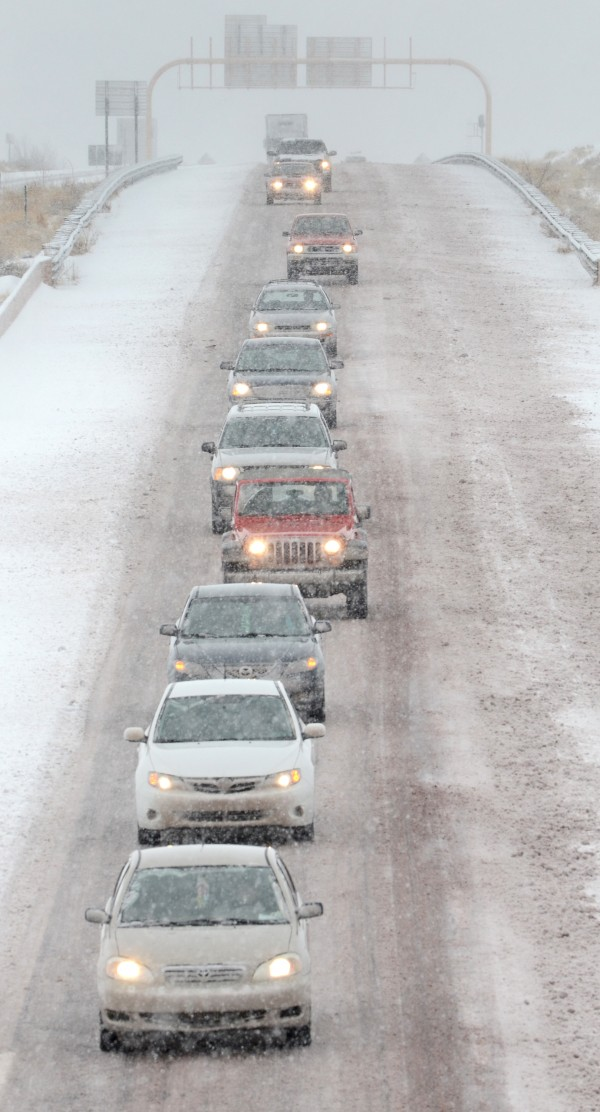 Northbound traffic on I-25 approaches Santa Fe, N.M. in a single file as snow accumulates on the road, Monday Dec. 19, 2011 as a winter storm hit the area. New Mexico state police say a winter storm is shutting highways and causing difficult driving across northern New Mexico. Los Alamos National Laboratory and a number of schools have closed as the storm moves across New Mexico and into the Texas and Oklahoma Panhandles and parts of Kansas and Colorado.