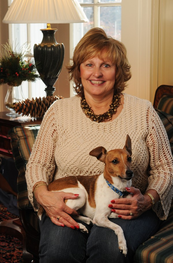 Maine's first lady Ann LePage poses in the sunroom of the Blaine House with the family dog, Baxter, in December 2011.