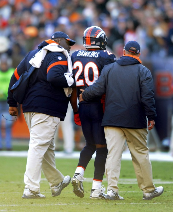 Denver Broncos strong safety Brian Dawkins (20) is helped off the field after suffering a neck injury in the first half of an NFL football game against the Chicago Bears, Sunday, Dec. 11, 2011, in Denver.