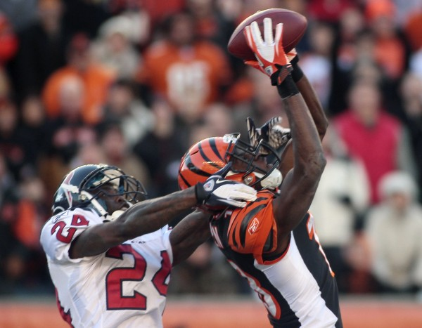 Cincinnati Bengals wide receiver A.J. Green catches a pass against Houston Texans cornerback Johnathan Joseph (24) during on Dec. 11, 2011,  in Cincinnati.