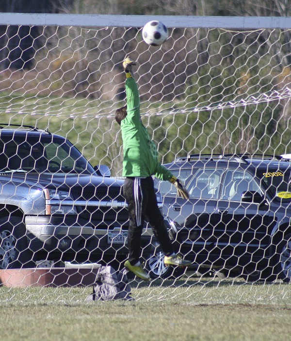 Kyle Townsend of Bronco Travel Soccer saves a penalty kick in a state 2011 semifinal against Yarmouth