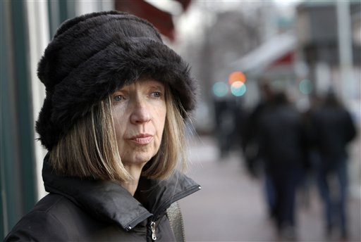 In this Dec. 18, 2010 photo, Kathleen Casey poses on a street in Cambridge, Mass. A case of mistaken identity landed Casey on the streets without a job or a home. The company hired to run her background check for a potential employer mistakenly found the wrong Kathleen Casey, who lived nearby but was 18 years younger and had a criminal record.