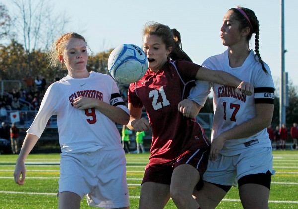 Bangor's Ashley Robinson (center) battles Scarborough's Emily Tolman (left) and Jessica Broadhurst in the Class D soccer state championship in Falmouth on Saturday, Nov. 5, 2011.