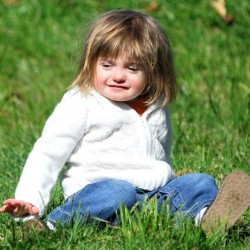 Kayla York, 4, plays in the grass this past summer. The 4-year-old has CHARGE syndrome, a genetic disorder that can cause multiple birth defects. A Bangor family recently donated a bone anchored hearing aid to Kayla.