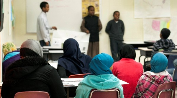 Dugsi Academy students listen to a presentation during social studies class. A 2010 study by the Civil Rights Project at UCLA found that higher percentages of charter-school students attend what the report called &quotracially isolated&quot schools, where 90 percent or more students are from a single race.