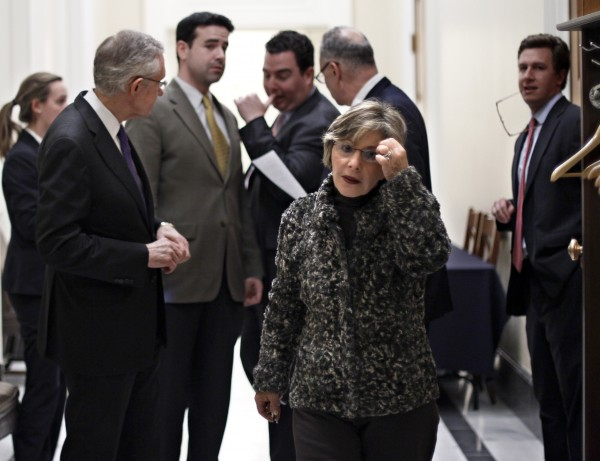 Sen. Barbara Boxer (center), D-Calif., leaves closed-door negotiations with Senate Majority Leader Harry Reid (left) of Nevada on the payroll tax cut extension and other measures Friday night, Dec. 16, 2011, at the Capitol in Washington.