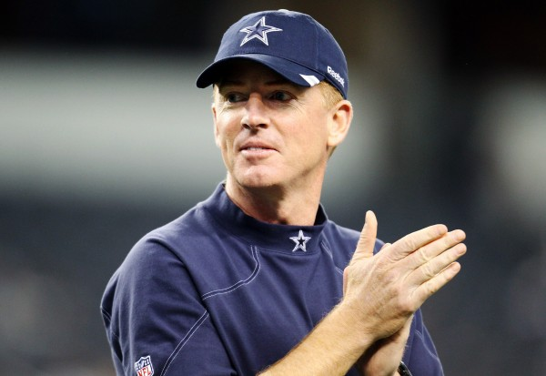 Dallas Cowboys head coach Jason Garrett watches his team warm up before an NFL football game against the Philadelphia Eagles, Saturday, Dec. 24, 2011, in Arlington, Texas.