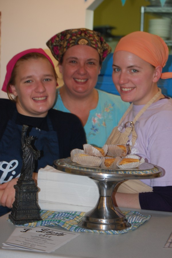 Tyra Mihalis Baker (center), owner of the Liberty Cafe in Eastport, is assisted at her restaurant by her daughters Anna (left) and Laura (right).