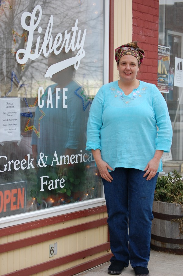 Tyra Mihalis Baker, the owner of the Liberty Cafe, stands outside her restaurant in Eastport recently.