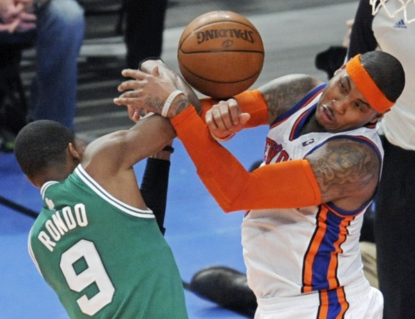 New York Knicks' Carmelo Anthony (right) and Boston Celtics' Rajon Rondo vie for the ball during the fourth quarter of an NBA basketball game Sunday, Dec. 25, 2011, at Madison Square Garden in New York. The Knicks defeated the Celtics 106-104.