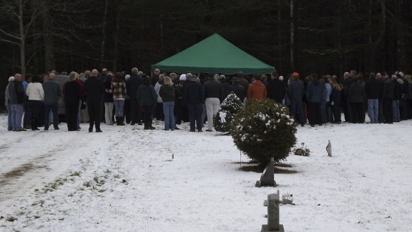 About 200 people attended the graveside funeral service at Townhouse Cemetery in Sangerville for Michael Curtis on Friday, Dec. 9. Curtis shot and killed Udo Schneider at Hilltop Manor in Dover-Foxcroft on Dec. 6 before driving to the Piscataquis County Fairgrounds, where he was shot and killed by Maine State Police in a standoff.