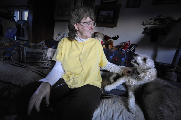 Janet Bouchard (right) spends some quality time with her four-year-old poodle Mason Bailey at her and her boyfriend Jack McCoy's home in Orland Monday, Dec. 12, 2011.