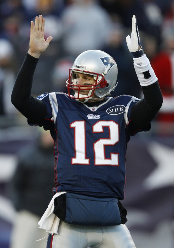 New England Patriots quarterback Tom Brady reacts against the Miami Dolphins during the second half of an NFL football game in Foxborough, Mass., Saturday Dec. 24, 2011.