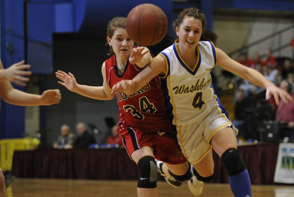 Fort Fairfield's Sydney Churchill (left) and Washburn's Rayah Saucier chase down a loose ball during last year's Eastern Maine Class D semifinal. Washburn won the game and went on to capture the state title, which it hopes to defend against such tough Aroostook County rivals as Fort Fairfield.
