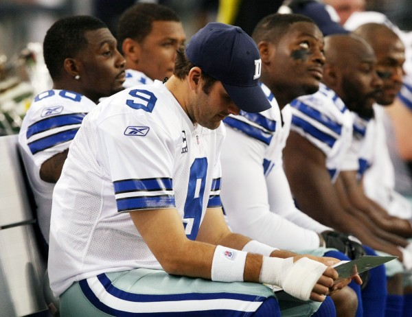 Dallas Cowboys quarterback Tony Romo (9) sits out with his throwing hand wrapped after being injured on the first series during the first half  of an NFL football game Saturday, Dec. 24, 2011, in Arlington, Texas.