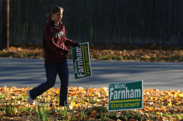State Sen. Nichi Farnham picks up campaign signs on Bangor's west side after 2010 elections.