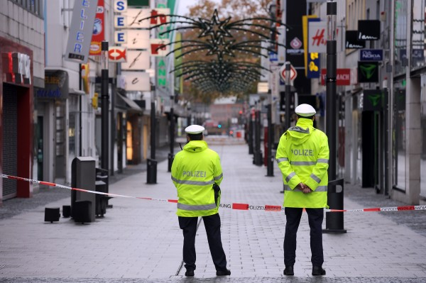 Police guard an empty shopping street in downtown Koblenz, Germany, on Sunday, Dec. 4, 2011.