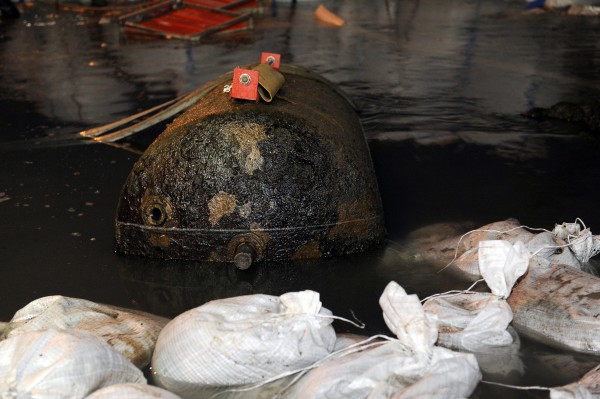 A defused WWII bomb sits in the Rhine River near Koblenz, Germany, Sunday, Dec. 4, 2011.