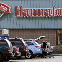A shopper loads groceries into her car at a Hannaford's grocery store in Auburn, Maine, Friday, Dec. 16, 2011.