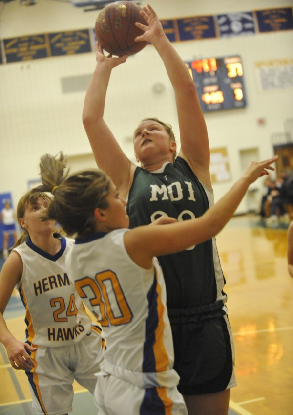 MDI's Delenn Colson (33) shoots over Hermon's Katie Kivler (30) and Jenna Crouse (24) during the third period of their basketball game at Hermon High School on Tuesday night, Dec. 27, 2011. In the background, on left, is MDI's Hannah Shaw (25).