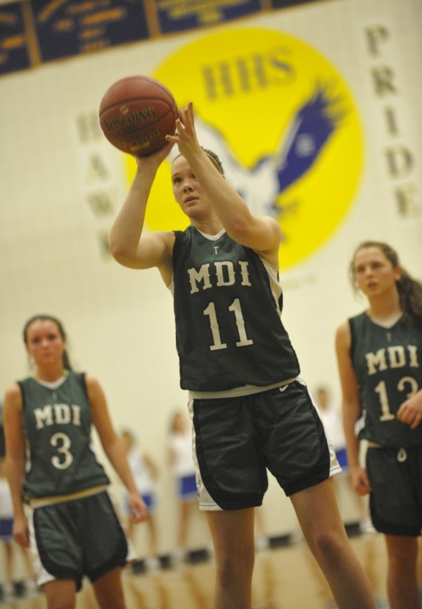MDI's Abby Jewett (11) puts up a free throw during the third period of their basketball game at Hermon High School on Tuesday night, Dec. 27, 2011. Behind her are teammates Sierra Myrick (3) and (right) Molly Carroll (13).