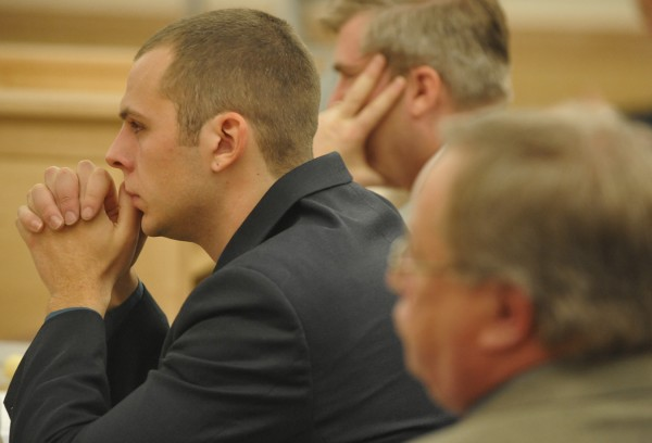 Seated between his attorney's Chuck Taitt (lower right) and William Bly, Garrett Cheney listens to Superior Court Justice William Anderson (not pictured) during Cheney's sentencing Wednesday, Dec. 7, 2011 at the Penobscot Judicial Center.