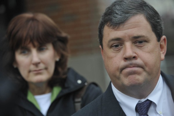 Louise Bakley (left) listens as her husband J.C. Bakley composes himself while addressing the media following the sentencing of Garrett Cheney at Penobscot Judicial Center on Wednesday, Dec. 7, 2011